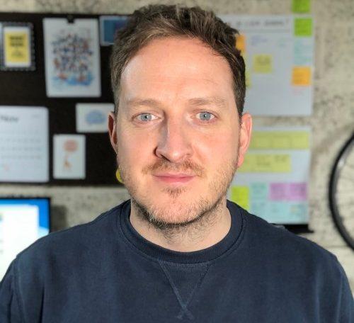 A headshot of Tim Brazier